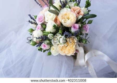 Colorful bouquet of the bride with roses, lavender and peonies, decoration for wedding