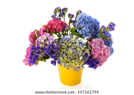 Colorful bouquet pink and blue Hydrangea in yellow bucket - stock photo