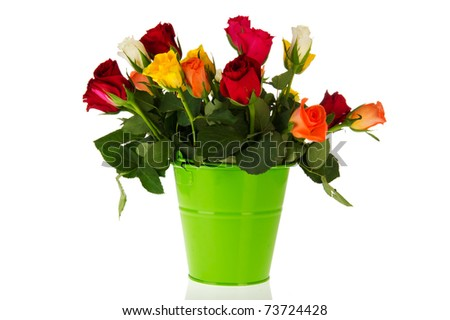 colorful bouquet roses in green bucket on white background