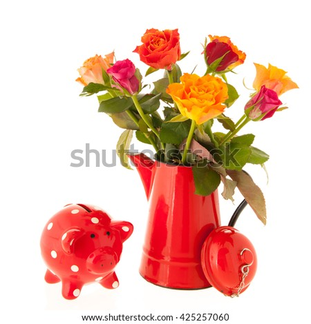 Colorful bouquet roses in red vase with piggy bank isolated over white background
