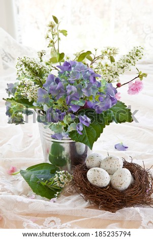 Colorful bouquet with hydrangea in vintage zinc pot
