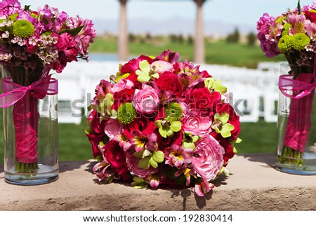 Colorful bouquets of flowers are a tradition at any wedding in the United States. There is a large bouquet for the bride and smaller ones for each of the Bridesmaids - stock photo