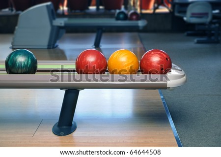 Colorful bowling balls ready to start