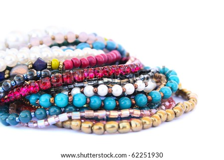 Colorful bracelets and necklaces isolated on white background. - stock photo