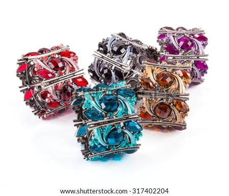 Colorful bracelets stone on white background. - stock photo