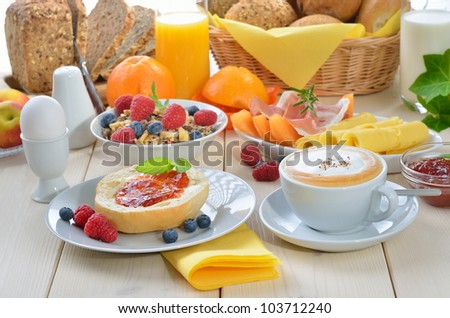 Colorful breakfast with cappuccino - stock photo