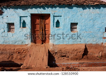 Colorful brick house in small indian town Orchha, Madhya Pradesh - stock photo