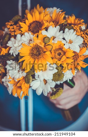 Colorful Bridal Bouquet in the groom's hand - stock photo