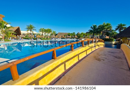 Colorful bridge over the swimming pool at the luxury mexican resort. Bahia Principe, Riviera Maya.