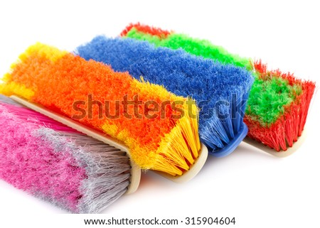 Colorful brooms isolated on white background. - stock photo