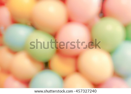 Colorful bubblegum balls, abstract blur for background and wallpaper (food background). Gumballs in a vending machine, closed up. Colorful background of assorted shiny round gumballs in pastel color. - stock photo