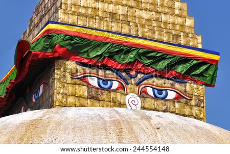 Colorful buddhist pagoda in Nepal (Bodnath) with Buddha's eyes of wisdom - stock photo