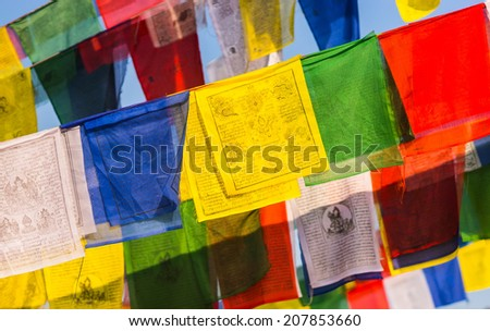 Colorful buddhist Prayer flags and blue sky. religion in Asia