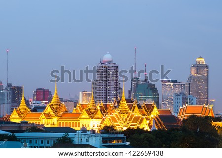 Colorful Buddhist temple under a clear blue sky, Thailand. - stock photo