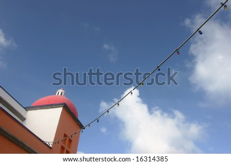 colorful building against blue sky and white clouds