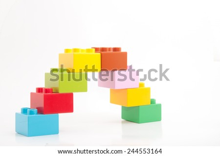 Colorful building blocks isolated on white - stock photo