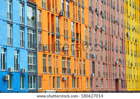 Colorful buildings and windows with air conditioners - stock photo