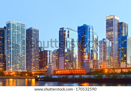 Colorful buildings in downtown Chicago during sunset with clear blue sky