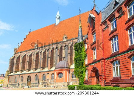 Colorful buildings in Nysa with St Jackob's bassilica in the background, Poland
