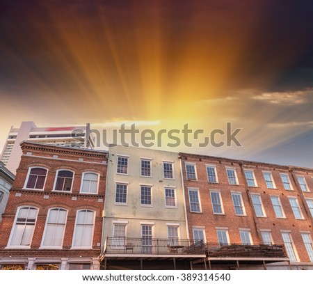 Colorful buildings of New Orleans at night. - stock photo