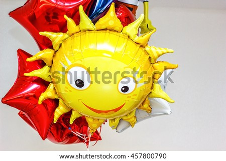 Colorful Bunch of Birthday Balloons Flying for Party and Celebrations With Space for Message Isolated in White Background. Smiling sun and star-shaped Flying Balloons. - stock photo