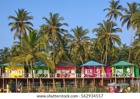 Colorful bungalows on Palolem beach, South Goa, India