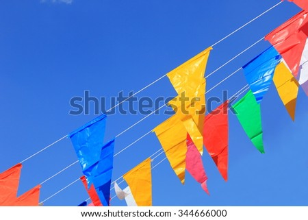colorful bunting background inside fun fair and various festival - stock photo