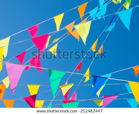 colorful bunting flags against a blue sky