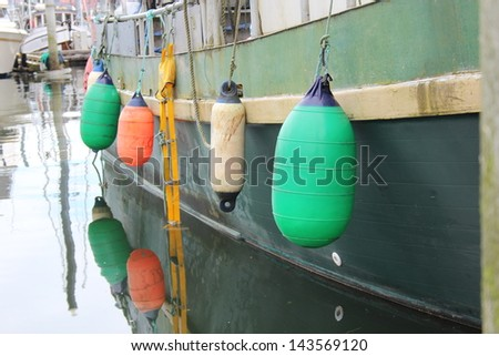 Colorful Buoy Bumpers on Commercial Fishing Boat in Petersburg Alaska Harbor