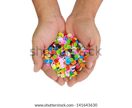 Colorful button in hand  isolate on white background
