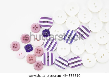 Colorful button texture with pink, purple and white buttons.