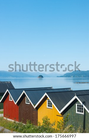 Colorful camping cabins on the fjord shore, Norway