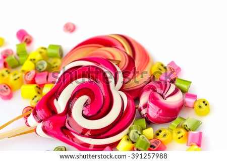 Colorful candies and lollipops on a white background - stock photo