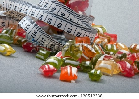 colorful candies and measurement - stock photo