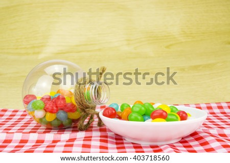 Colorful candies in bottles with shallow depth of field (dof)-diet and healthy teeth concept - stock photo