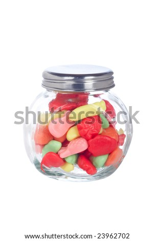 Colorful candies in the glass jar isolated on white background