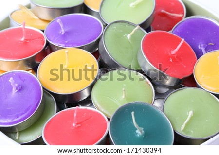 colorful candles in bowl