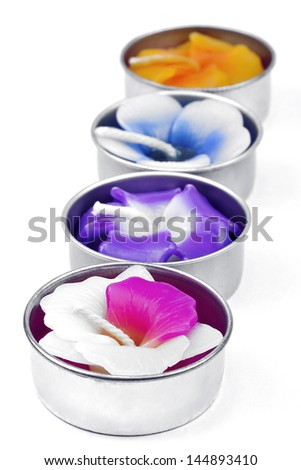 Colorful candles on white background.