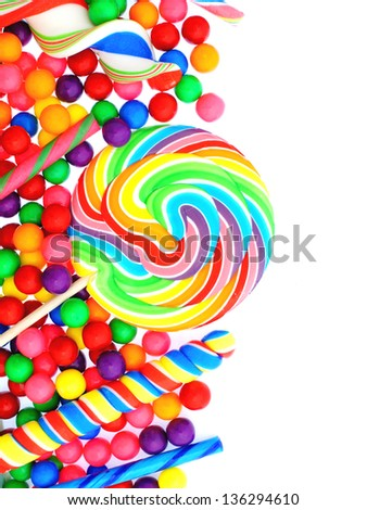 Colorful candy corner border with lollipops and gumballs - stock photo