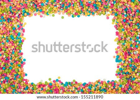 Colorful candy decoration frame over white background with copy space - stock photo