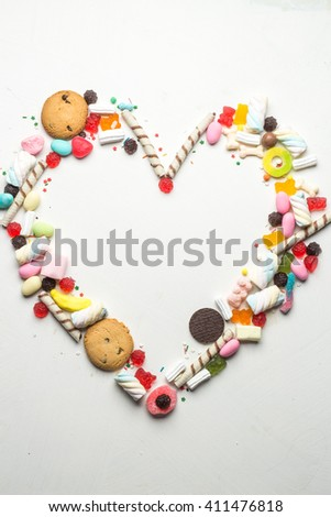 Colorful candy frame on white background - stock photo