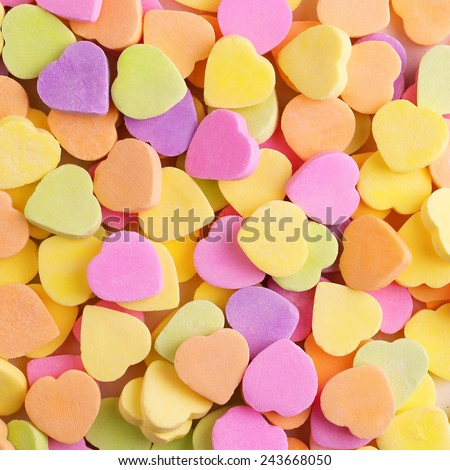 Colorful candy hearts. Background - stock photo