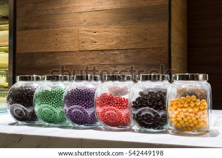 colorful candy in glass jar on the marble counter