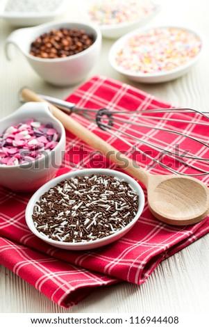 colorful candy sprinkles in ceramic bowl - stock photo