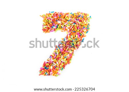 Colorful candy sprinkles number seven isolated on white background - stock photo