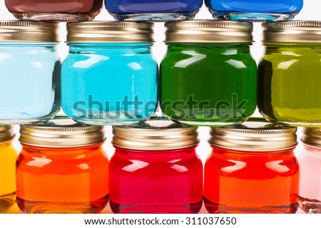 Colorful Canning Jars filled with brightly colored water - Rainbow Colors