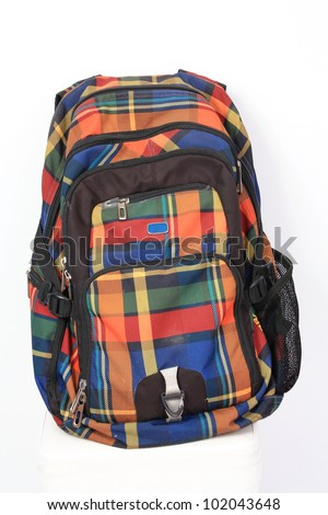 Colorful canvas backpack in studio - stock photo