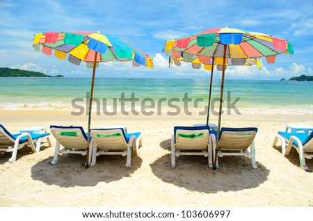 Colorful canvas beds on the beach with beautiful blue sky at phuket