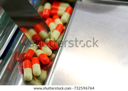 colorful capsule medicine on metal plate for prepare to separate packaging