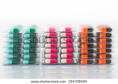 Colorful capsules of oral medications in transparent strips. - stock photo